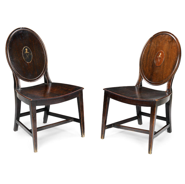 A pair of George III mahogany hall chairs
