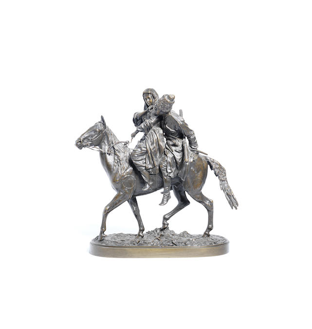 A bronze group of a couple on horseback