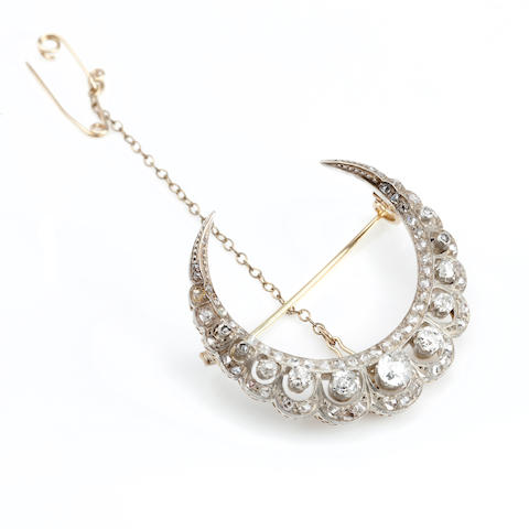 A Victorian diamond crescent brooch