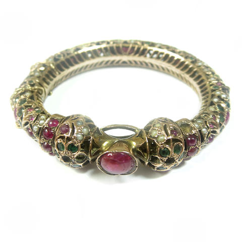 A gem-set bangle