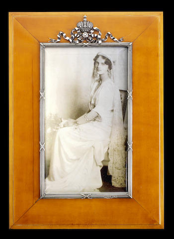A silver-gilt and wood photograph frame