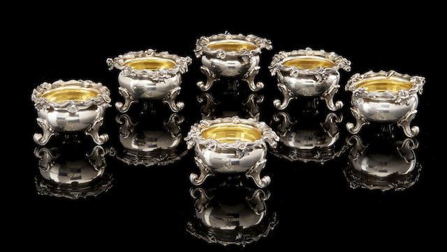 A set of six parcel-gilt salt cellars