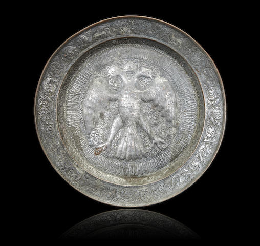 a copper and pewter commemorative platter