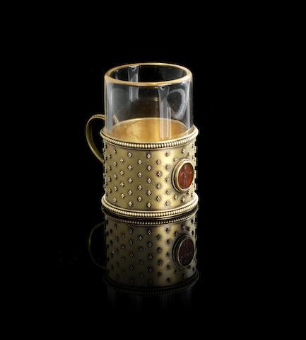 A miniature gold tea-glass holder