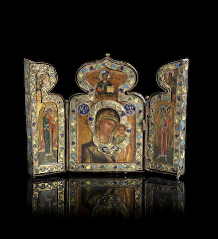 A gilt-metal and enamel travelling triptych icon
