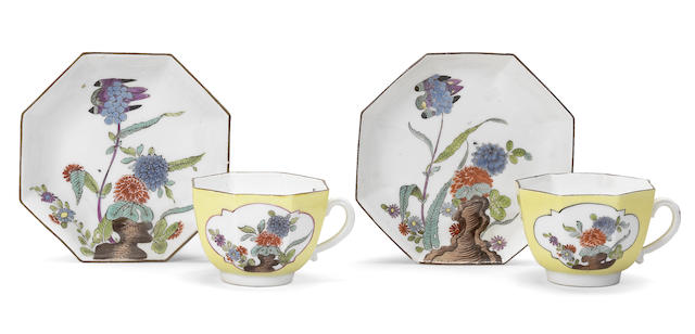 Two Meissen octagonal yellow-ground cups and saucers