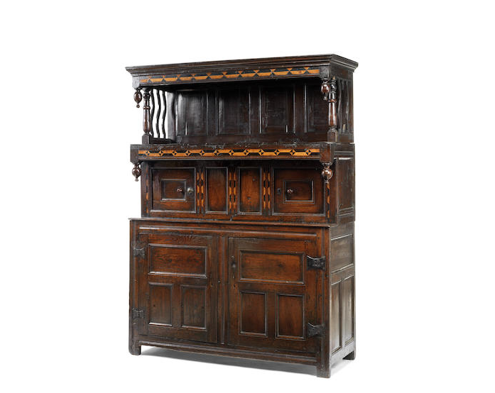 A mid 18th century oak and geometric fruitwood inlaid tridarn, North Wales