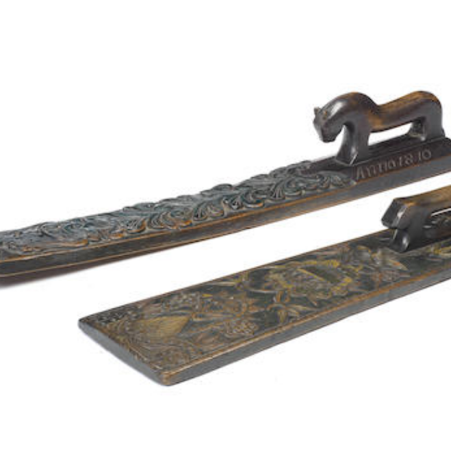 Two early 19th century Scandinavian carved oak polychrome mangle boards