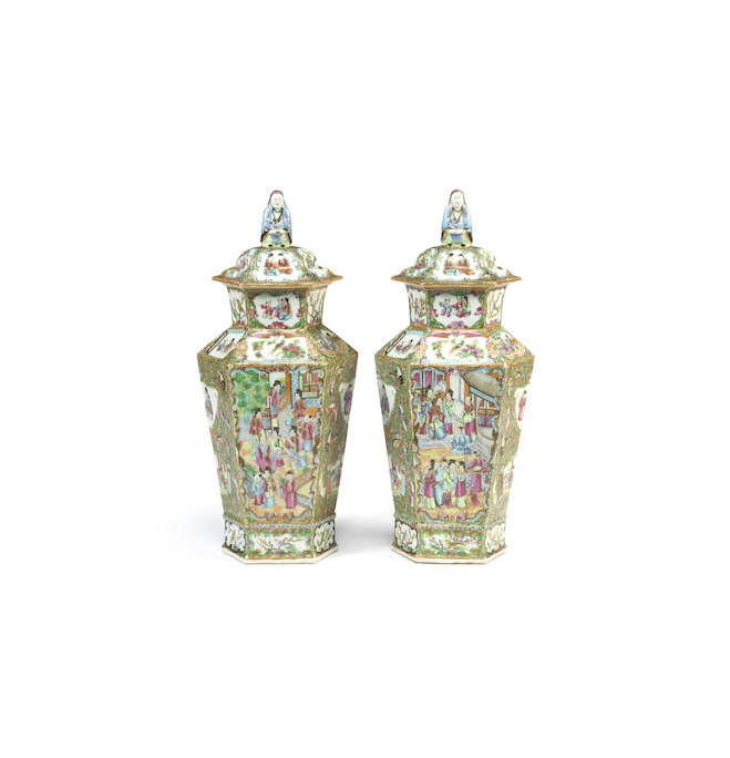 A pair of Chinese 'Canton' famille rose hexagonal baluster vases and covers