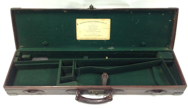 A Stephen Grant & Joseph Lang brass-mounted leather guncase