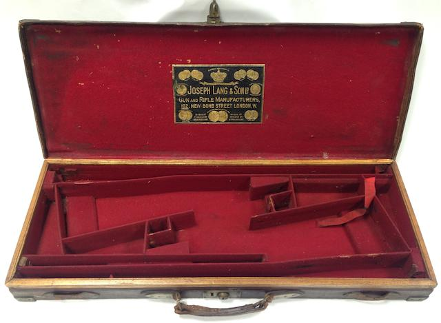 A Joseph Lang & Son brass-mounted oak and leather double-guncase