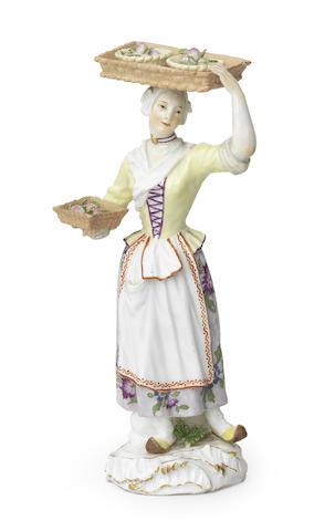 A Meissen figure of a fruit or vegetable seller