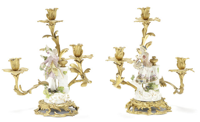A rare pair of Meissen figures mounted on ormolu candelabra