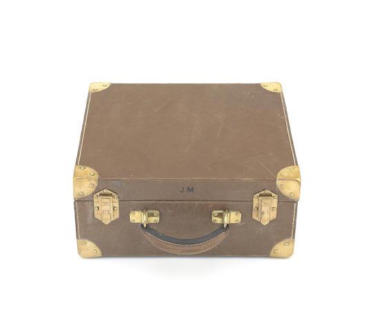 A fine Hermès brass-mounted leather cartridge-magazine