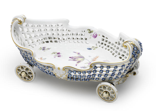 A very rare Meissen pierced basket on four porcelain wheels