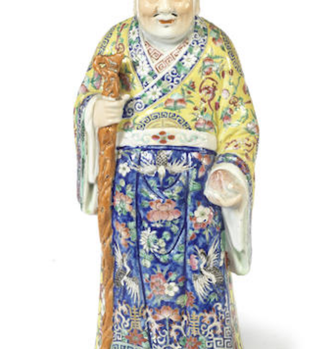 A Chinese famille rose figure of a Daoist