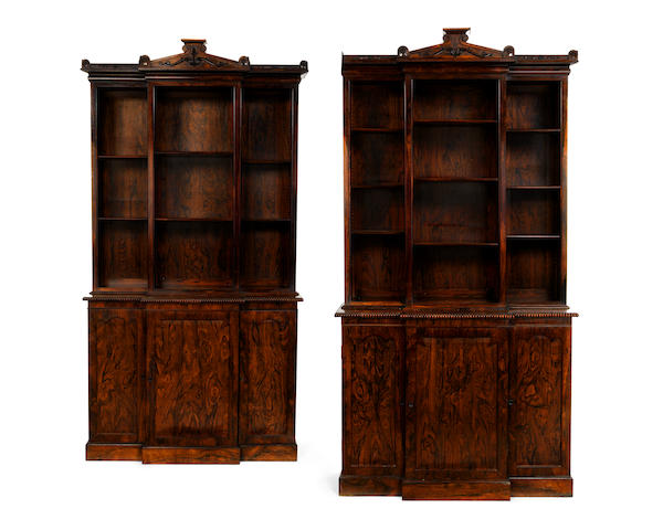 A pair of William IV rosewood and rosewood grained breakfront bookcases