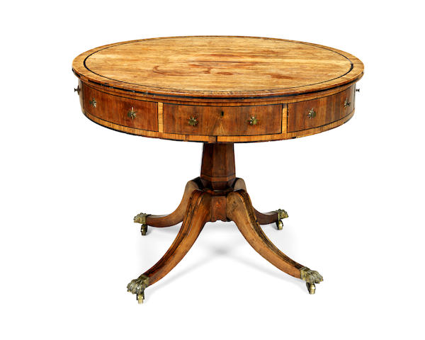 A George III rosewood, crossbanded and ebony strung drum top centre table