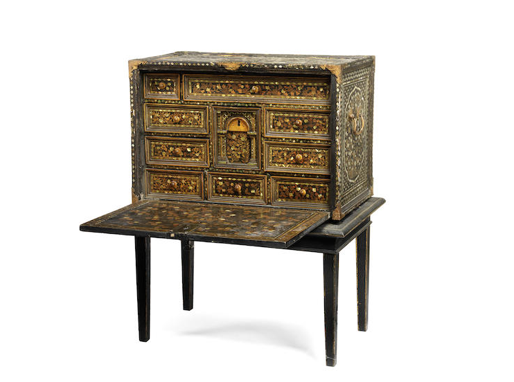 A Japanese Namban 17th century black lacquered, mother of pearl inlaid and gilt decorated cabinet on later stand