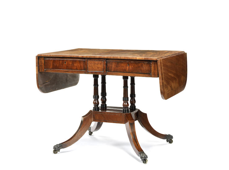 A Regency mahogany, satinwood crossbanded and boxwood strung sofa table