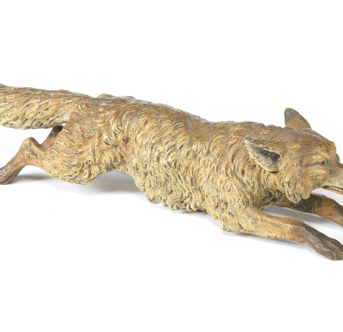 An Austrian late 19th century cold painted bronze of a running fox
