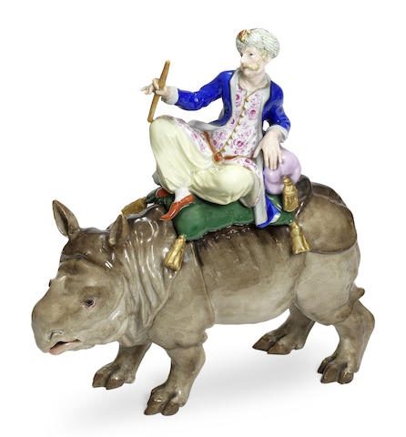 A Meissen group of a Turkish Sultan riding a rhinoceros