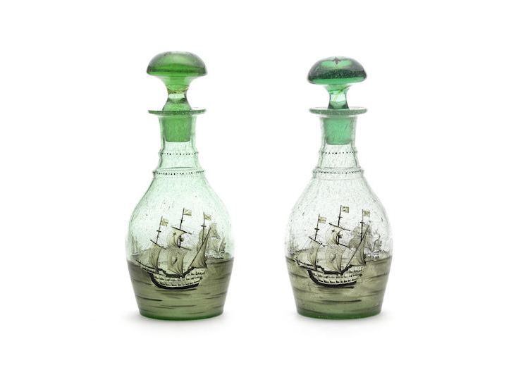 A pair of Dutch glass mallet shaped decanters and stoppers