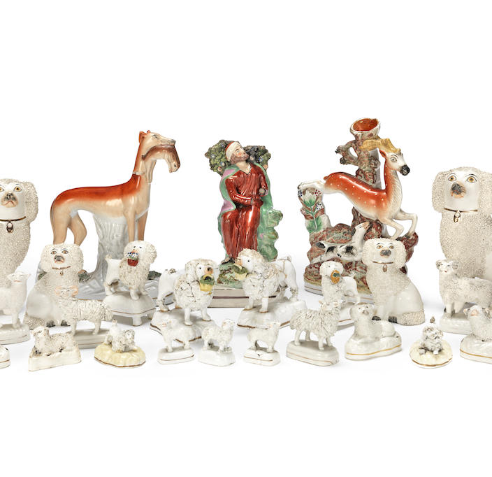 A collection of Staffordshire animals and a figure of Elijah