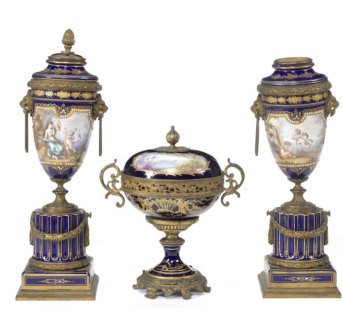 A late 19th century three piece porcelain garniture