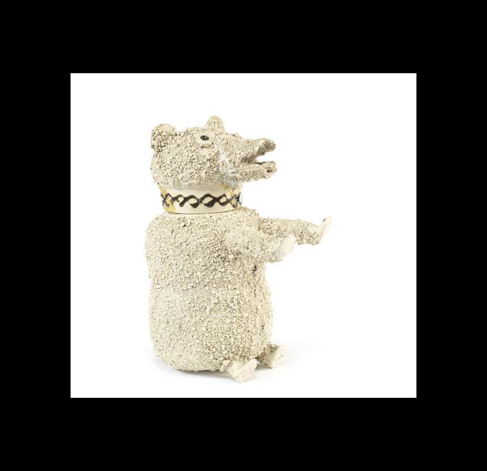 A Staffordshire white saltglaze bear jug and cover