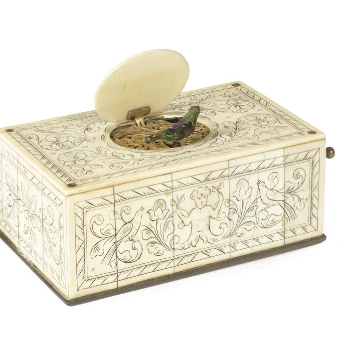 A 19th century French or Swiss ivory automota music box