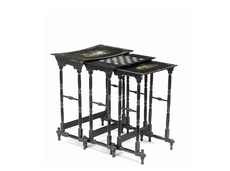 A Victorian nest of three ebonised and polychrome decorated papier-mâché tables