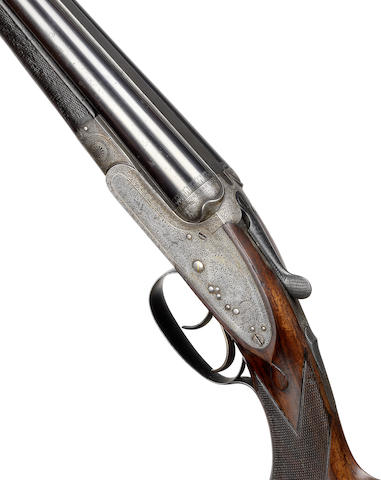 A .303 sidelock ejector rifle by Alex Henry, no. 7013