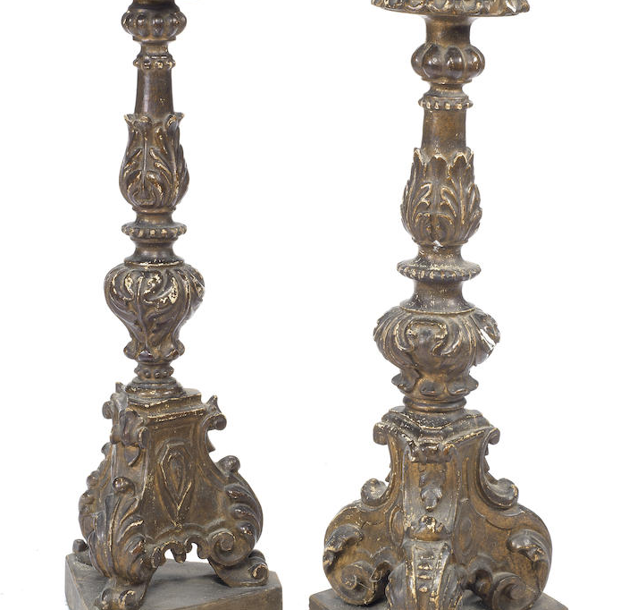A pair of North Italian 19th century carved giltwood candlesticks