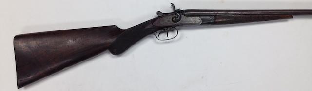 A .410 hammer gun by I. Hollis & Son, no. 64277