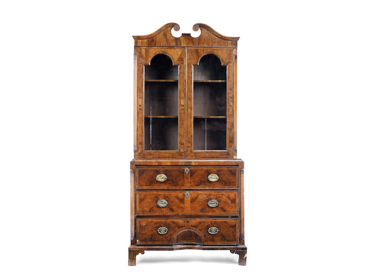 A George II walnut and feather banded secretaire bookcase