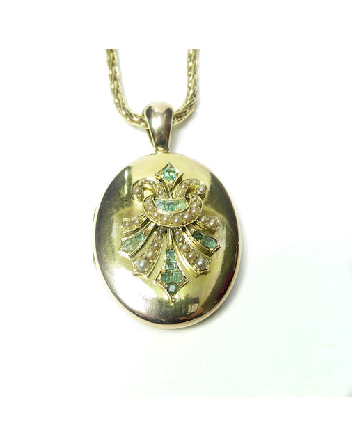 A late Victorian emerald and seed pearl pendant locket