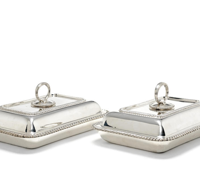 A pair of George V silver entrée dishes and covers