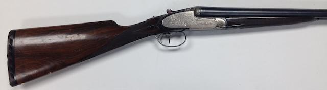 A 12-bore sidelock ejector gun by L. C. Smith, no. RE38318