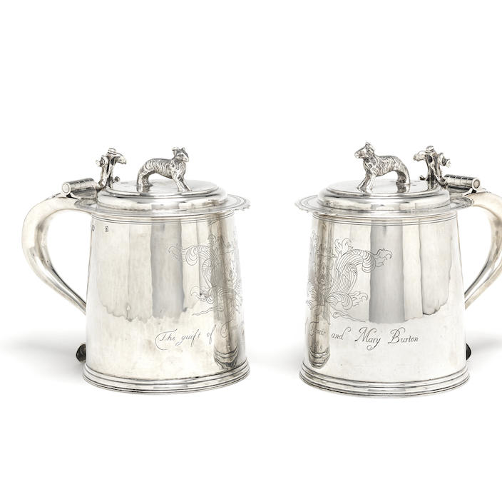 A pair of silver lidded tankards