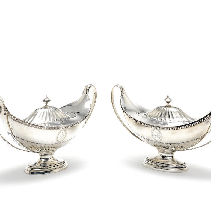 A pair of Neo-Classical George III silver sauce tureens and covers