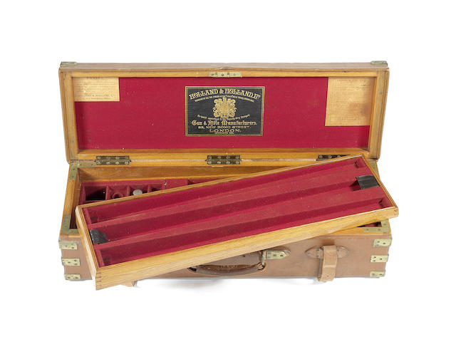 A fine Holland & Holland two-tier brass-mounted oak and leather triple-guncase with canvas cover