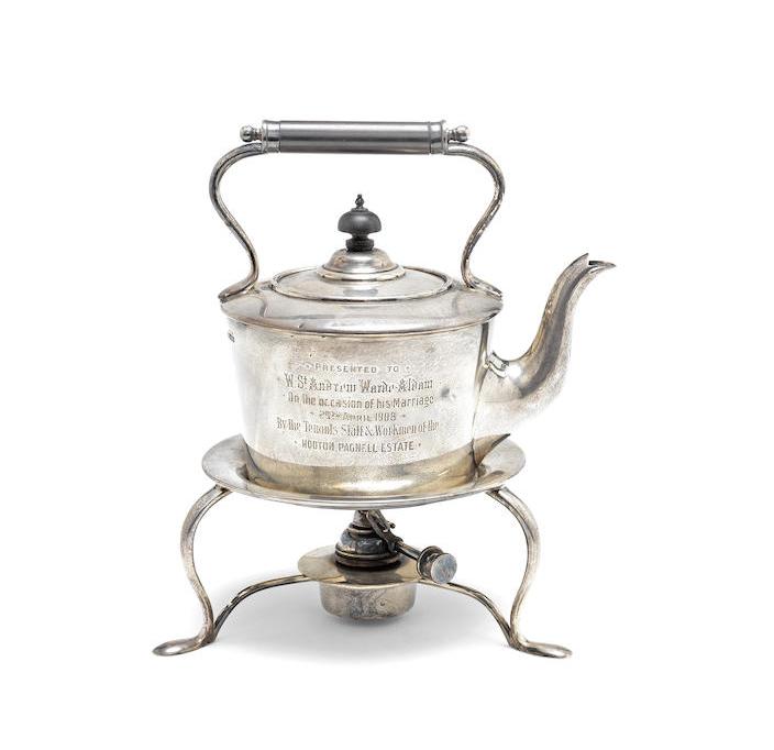 An Edwardian silver kettle on spirit stand