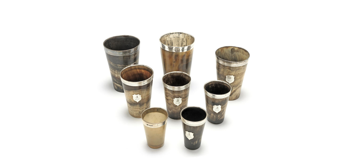 A set of six Victorian graduated silver-mounted horn beakers