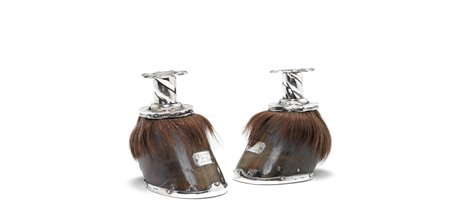 A pair of Victorian silver-mounted horse hoof candlesticks