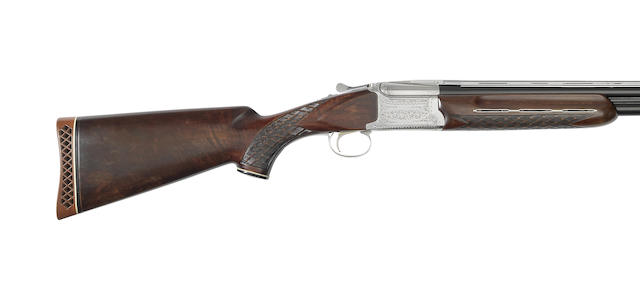 A 12-bore single-trigger over-and-under ejector gun by Nikko, no. K700373