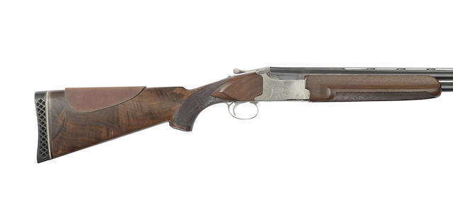 A 12-bore 'pigeon-grade' single-trigger over-and-under ejector gun by Winchester, no. PK427189