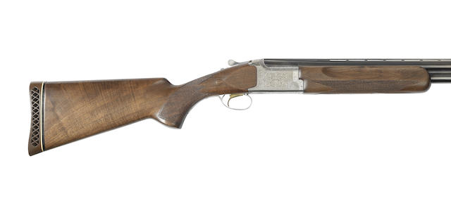 A 12-bore single-trigger over-and-under ejector gun by Miroku, no. 80002PM