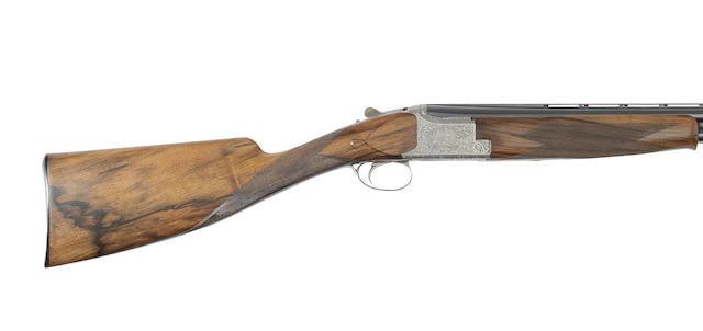 An E. Vos-engraved 12-bore 'Diana Model' single-trigger over-and-under game gun by F.N., no. 863RR65209