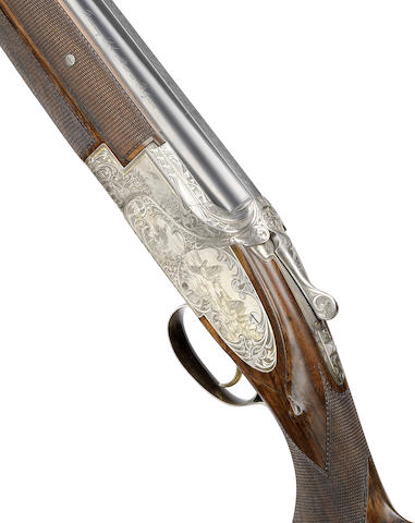 A fine S. Macahenko-engraved 12-bore 'B25 Windsor OR' single-trigger over-and-under ejector gun by Browning, no. 325MX03993